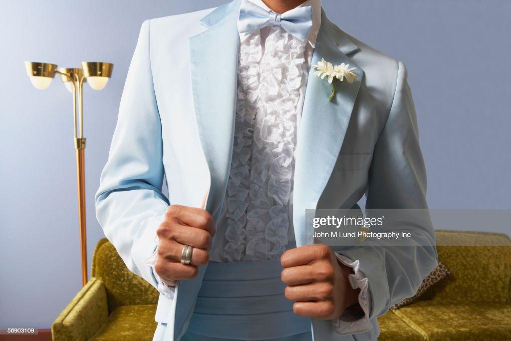 Torso view of young man in tuxedo