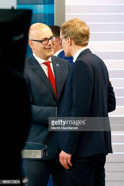 Torsten Albig incumbent candidate of the German Social Democrats shakes hand with Daniel Guenther lead candidate of the German Christian Democrats at...