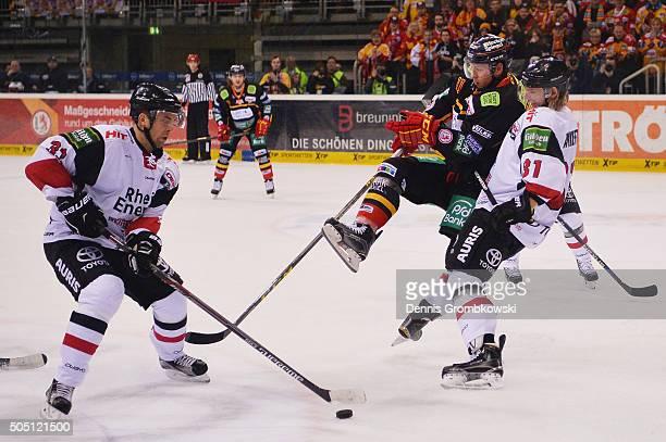 Torsten Ankert of Koelner Haie holds Eduard Lewandowski of Duesseldorfer EG during the Ice Hockey DEL match between Duesseldorfer EG and Koelner Haie...