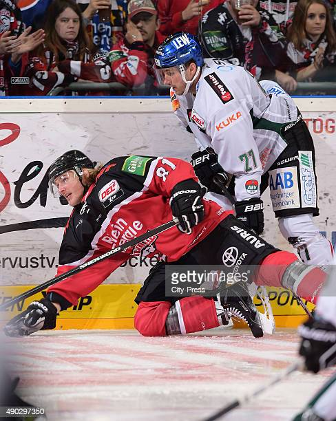 Torsten Ankert of the Koelner Haie and Ivan Ciernik of the Augsburger Panther during the DEL game between Koelner Haie and the Augsburger Panther on...