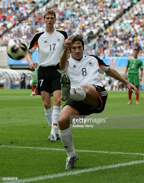 Torsten Frings and Per Mertesacker of Germany in action during the game between Germany and Mexico for the third place of the FIFA Confederations Cup...