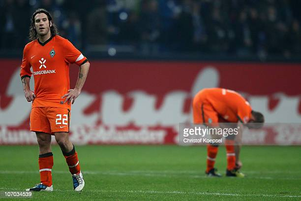 Torsten Frings and Petri Pasanen of Bremen look dejected after losing the Bundesliga match between FC Schalke 04 and SV Werder Bremen at Veltins...