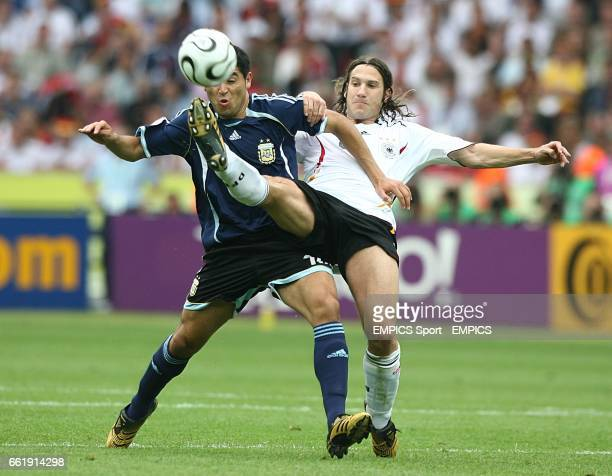 Torsten Frings Germany and Juan Riquelme Argentina battle for the ball