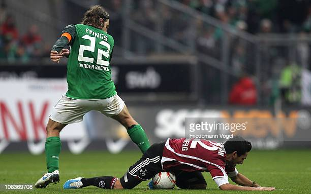 Torsten Frings of Bremen and Ilkay Guendogan of Nuernberg battle for the ball during the Bundesliga match between SV Werder Bremen and 1 FC Nuernberg...