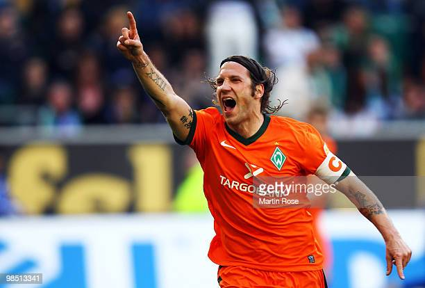 Torsten Frings of Bremen celebrates after scoring his team's third goal during the Bundesliga match between VfL Wolfsburg and SV Werder Bremen at the...