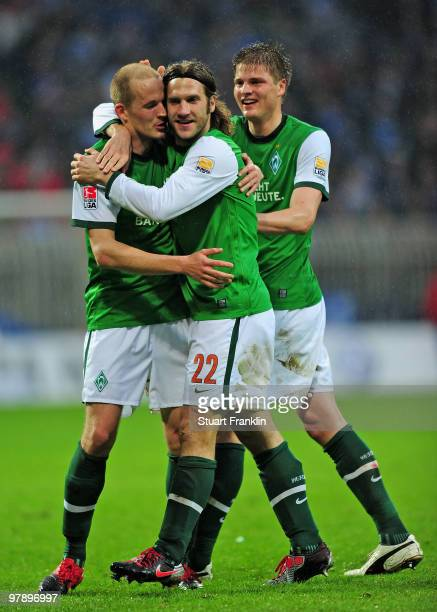 Torsten Frings of Bremen celebrates scoring his team's third goal with Sebastian Prödl and Petri Pasanen during the Bundesliga match between SV...