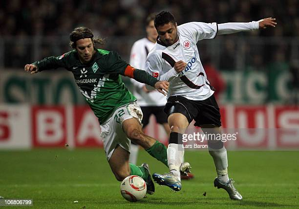 Torsten Frings of Bremen challenges Caio of Frankfurt during the Bundesliga match between SV Werder Bremen and Eintracht Frankfurt at Weser Stadium...