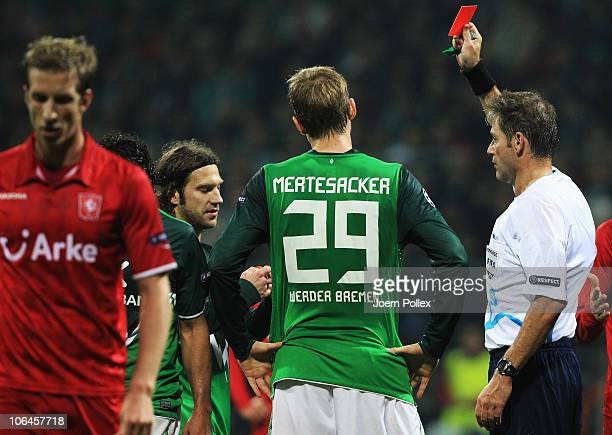 Torsten Frings of Bremen gets the red card from referee Alain Hamer during the UEFA Champions League group A match between SV Werder Bremen and FC...