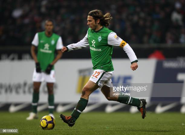 Torsten Frings of Bremen plays the ball during the Bundesliga match between Werder Bremen and FC Bayern Muenchen at Weser Stadium on January 23 2010...