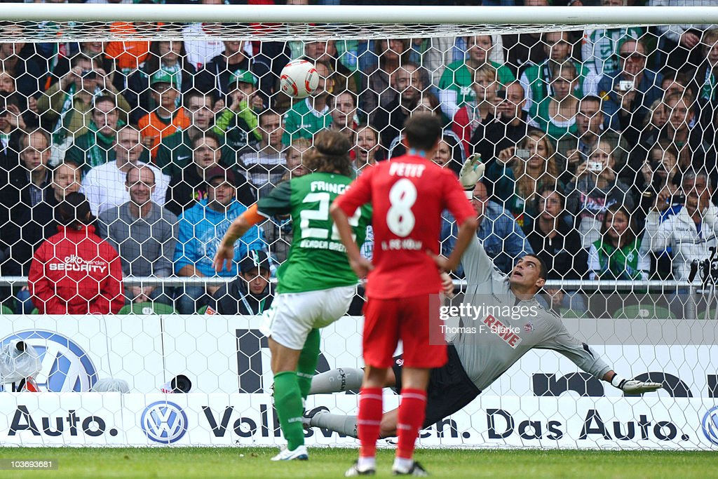 Torsten Frings (L) of Bremen scores a penalty against Faryd Mondragon (R) of Koeln during the Bundesliga match between Werder Bremen and 1. FC Koeln at the Weser Stadium on August 28, 2010 in Bremen, Germany.