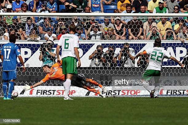 Torsten Frings of Bremen scores his team's first goal with a penalty against goalkeeper Tom Starke of Hoffenheim during the Bundesliga match between...
