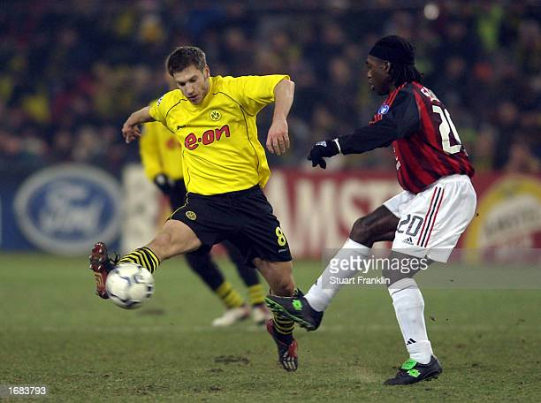 Torsten Frings of Dortmund and Clarence Seedorf of AC Milan during The Champions league match between Borussia Dortmund and AC Milan at The Westfalen...