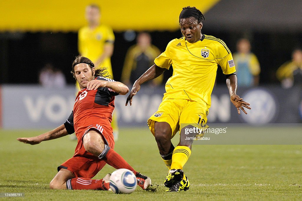 Torsten Frings #22 of Toronto FC attempts to slide in to kick the ball away as Andres Mendoza #10 of the Columbus Crew controls the ball on September 10, 2011 at Crew Stadium in Columbus, Ohio. Mendoza had a goal in a 4-2 loss to Toronto FC.