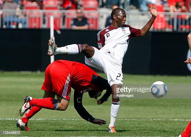 Torsten Frings of Toronto FC crashes into Sanna Nyassi of Colorado Rapids during MLS action at the BMO Field September 17 2011 in Toronto Ontario...