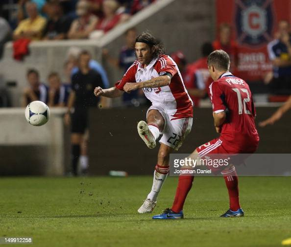 Torsten Frings of Toronto FC passes around Logan Pause of the Chicago Fire during an MLS match at Toyota Park on August 4 2012 in Bridgeview Illinois...