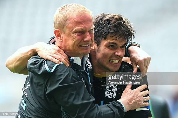 Torsten Froehling head coach of 1860 Muenchen celebrates his team winning goal with his team captain Christoph Schindler during the Second Bundesliga...