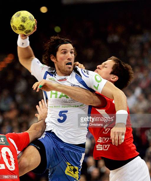 Torsten Jansen of Hamburg competes with Thomas Klidgaard of Melsungen during the Bundesliga game between HSV Handball and MT Melsungen at the Color...