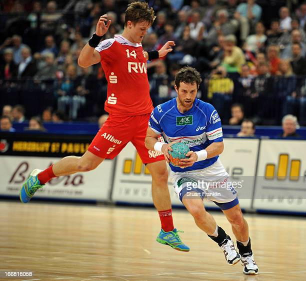 Torsten Jansen of Hamburg is challenged byNiclas Pieczkowski of Essen during the DKB Bundesliga handball game between HSV Hamburg and TUSEM Essen at...