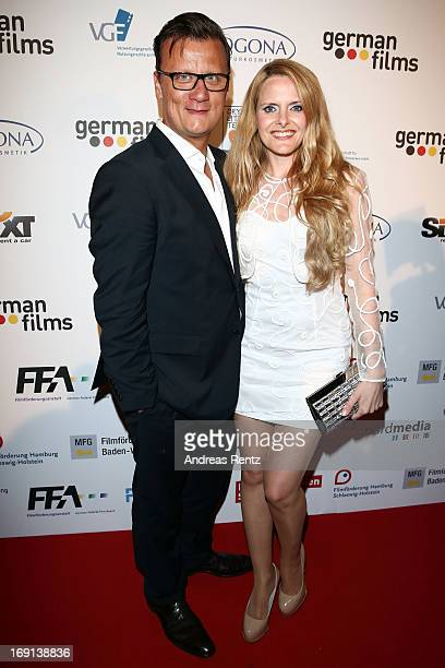 Torsten Koch and Daniela Vukovic attend the German Films reception during the 66th Annual Cannes Film Festival at the Majestic Beach on May 20 2013...
