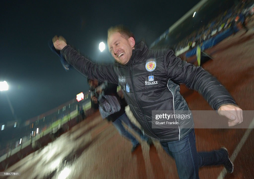 Torsten Lieberknecht, head coach of Braunschweig celebrates at the end of the Second Bundesliga match between Eintracht Braunschweig and1. FC Union Berlin at the eintracht stadium on December 17, 2012 in Braunschweig, Germany.
