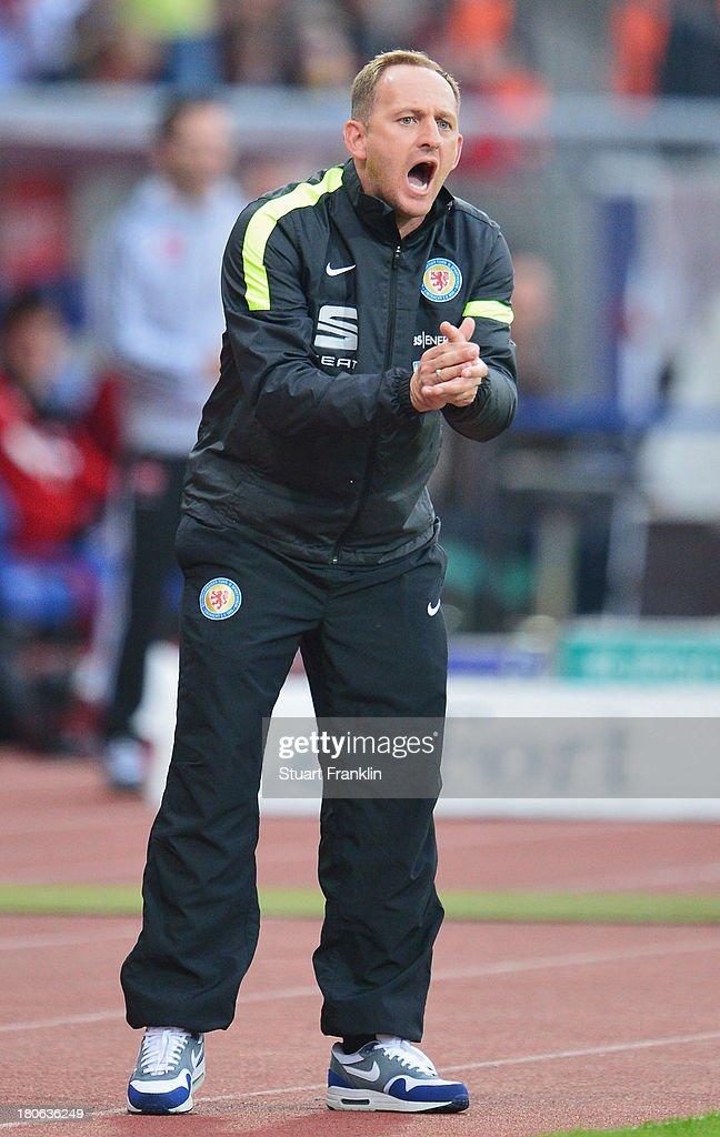 Torsten Lieberknecht, head coach of Braunschweig gestures during the Bundesliga after the Bundesliga match between Eintracht Braunschweig and 1. FC Nuernberg at Eintracht Stadion on September 15, 2013 in Braunschweig, Germany.