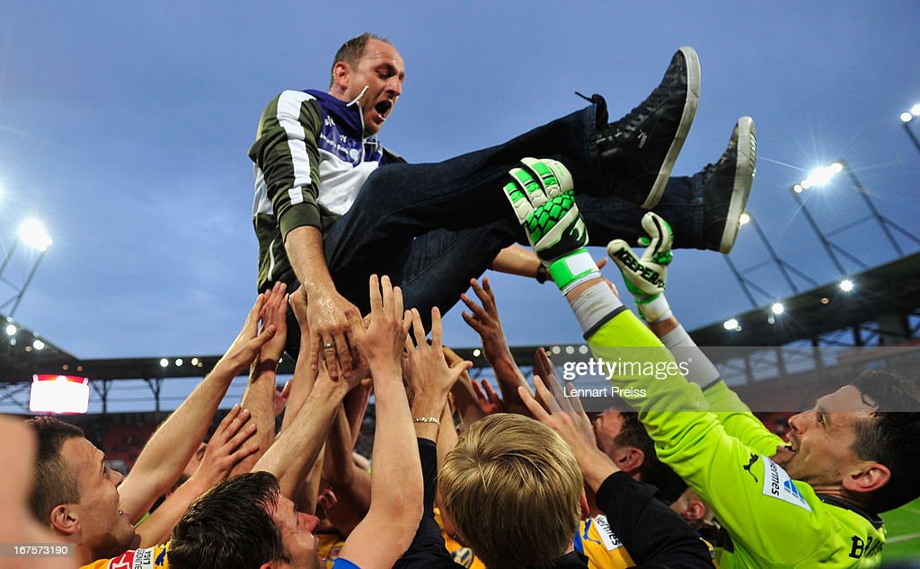 Torsten Lieberknecht (C), head coach of Braunschweig, is tossed into the air by his team as they celebrate promotion to the 1. Bundesliga after the 2. Bundesliga match between FC Ingolstadt and Eintracht Braunschweig on April 26, 2013 in Ingolstadt, Germany.