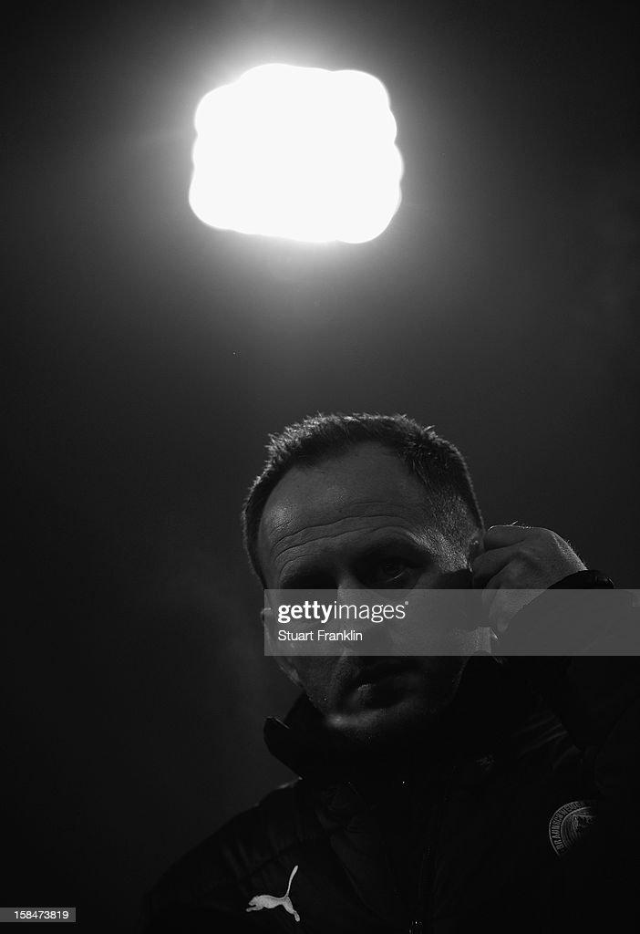 Torsten Lieberknecht, head coach of Braunschweig ponders during the Second Bundesliga match between Eintracht Braunschweig and1. FC Union Berlin at the eintracht stadium on December 17, 2012 in Braunschweig, Germany.
