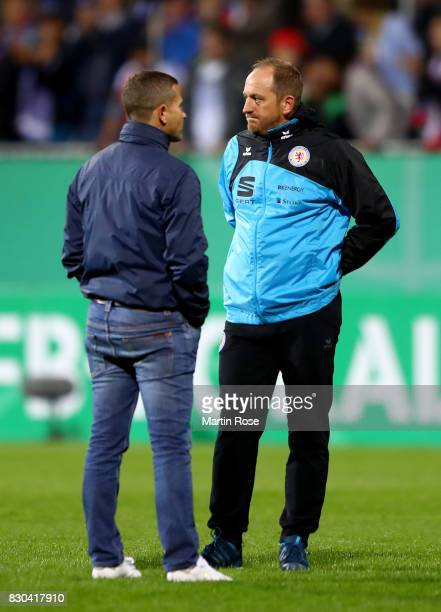Torsten Lieberknecht head coach of Braunschweig talks to sport director Marc Arnold after the DFB Cup first round match between Holstein Kiel and...