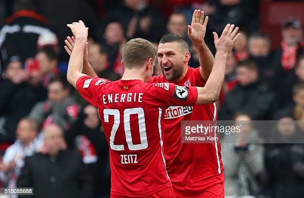 Torsten Mattuschka of Cottbus and team mate Manuel Zeitz show their delight after winning the third league match between FC Energie Cottbus and 1FC...