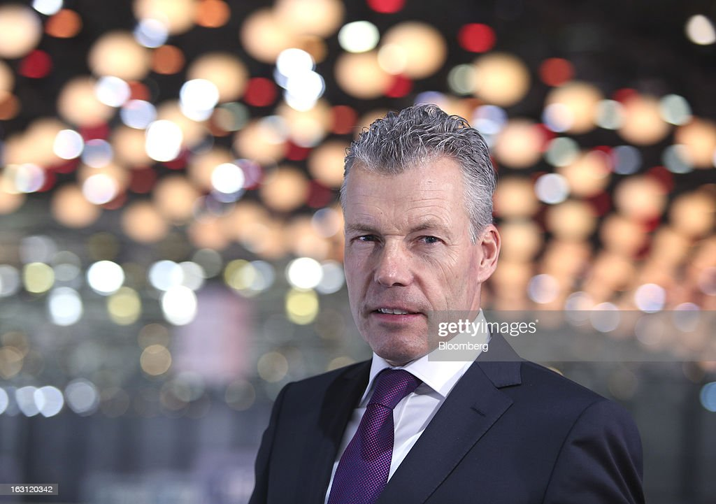 Torsten Mueller-Oetvoes, chief executive officer of Rolls-Royce Motor Cars Ltd., pauses during a television interview on the first day of the 83rd Geneva International Motor Show in Geneva, Switzerland, on Tuesday, March 5, 2013. This year's show opens to the public on Mar. 7, and is set to feature more than 100 product premiers from the world's automobile manufacturers. Photographer: Chris Ratcliffe/Bloomberg via Getty Images