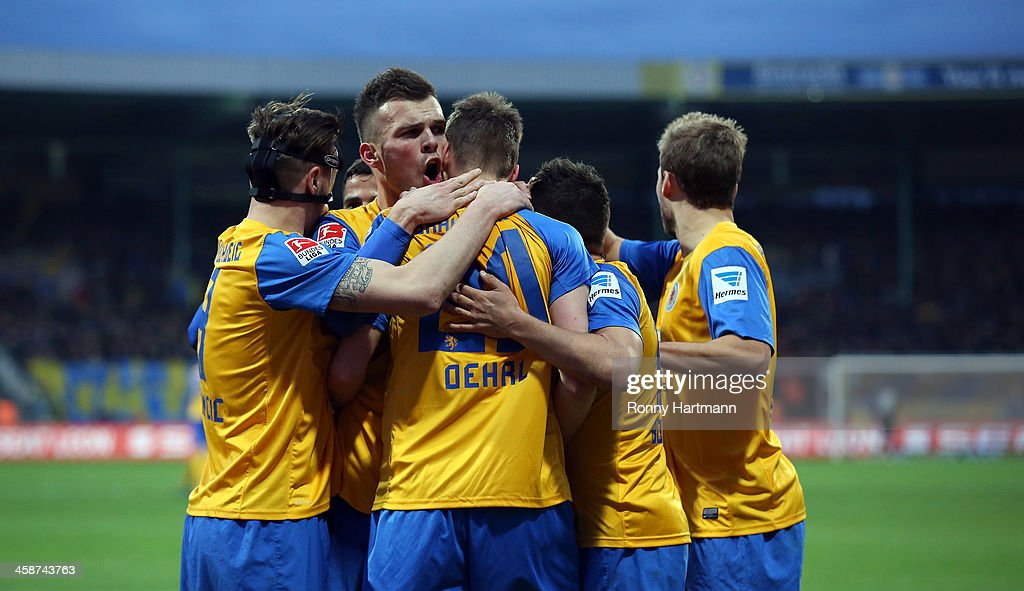 Torsten Oehrl of Braunschweig celebrates his teams opening goal with team mates during the Bundesliga match between Eintracht Braunschweig and 1899...