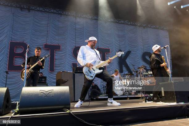 Torsten Scholz Thomas Goetz Arnim TeutoburgWeiss and Bernd Kurtzke of Beatsteaks perform on stage during the second day of 'Rock am Ring' on June 3...