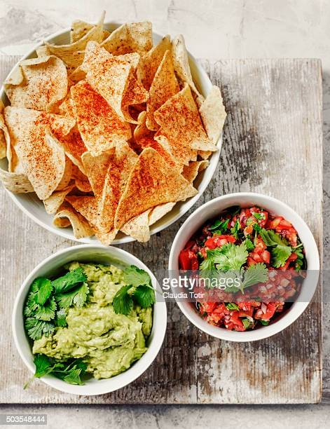 Tortilla chips with salsa and guacamole