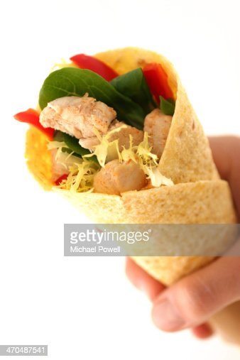 Tortilla wrap being held : Stock Photo