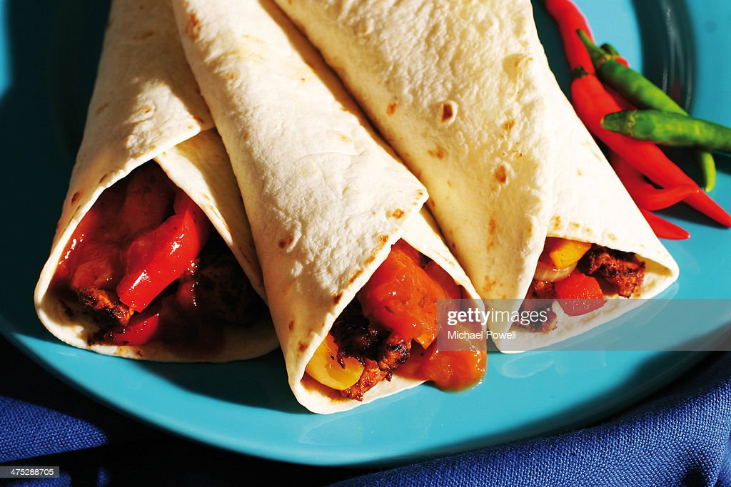 Tortilla wraps with chicken and peppers : Stock Photo
