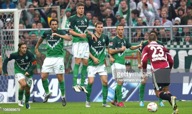 Tortsen Frings Hugo Almeida Sebastian Proedel Per Mertesacker Marko Arnautovic and Claudio Pizarro of Bremen jumps in the wall during a free kick...