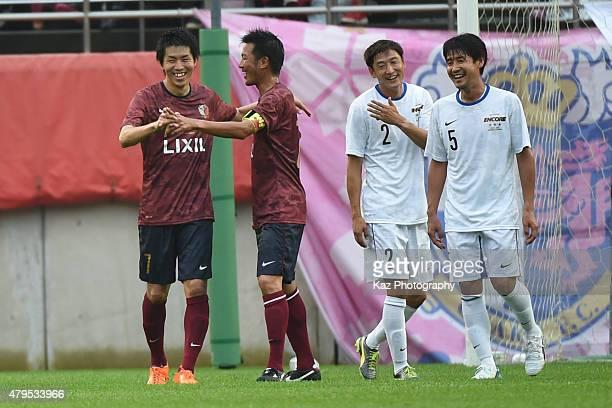 Toru Araiba of Kashima Legends celebrates the 2nd goal with Atsushi Yanagisawa of Kashima Legends during the J League 2015 retirement game at Kashima...