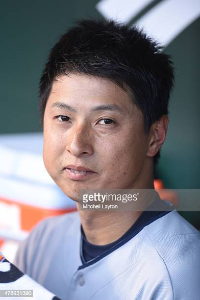 Toru Murata of the Cleveland Indians looks on from the dug out in his major league debut in the first inning during game two of a baseball game...