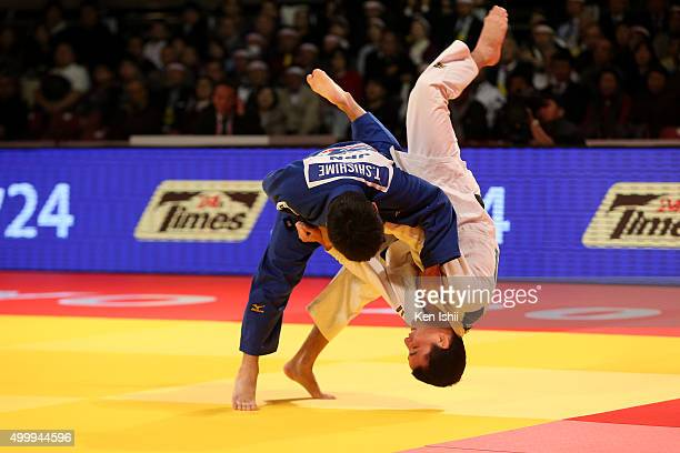 Toru Shishime of Japan throws Felipe Kitadai of Brazil for a ippon in the Men's 60kg bronze medal match at Tokyo Metropolitan Gymnasium on December 4...