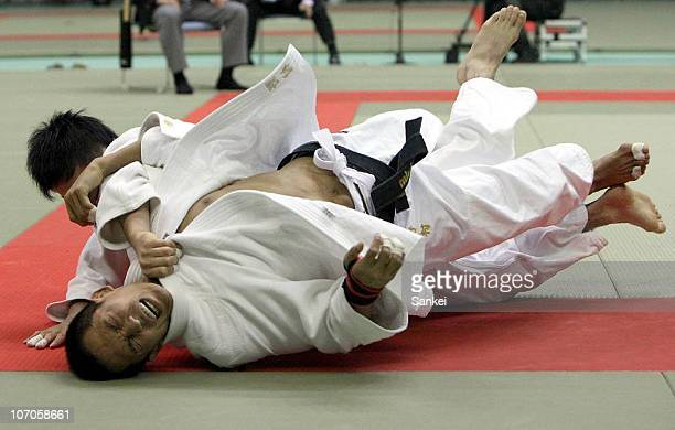 Toru Shishime throws Tadahiro Nomura in the second round of the Men's 60kg during the Kodokan Cup Judo at Chiba Port Arena on November 21 2010 in...