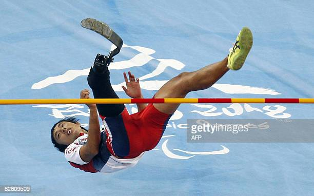 Toru Suzuki of Japan clears the bar during the final of the men's high jump F44/46 classification event at the 2008 Beijing Paralympic Games in...