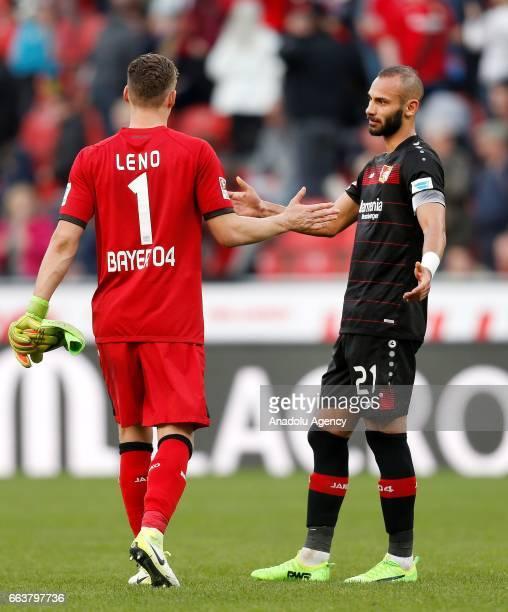 LEVERKUSEN GERMANY APRIL 2 Torwart Bernd Leno and Omer Toprak shake hands after the 33 at the Bundesliga soccer match between Bayer Leverkusen and...