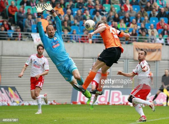 Torwart Fabio Coltorti of RB Leipzig saves the ball against Sandro Sirigu of Darmstadt during the 3rd Liga match between RB Leipzig and SV Darmstadt...