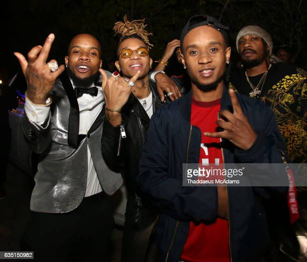 Tory Lanez Swae Lee and Slim Jxmmi pose for a picture at The Friends Keep Secrets Grammy After Party on February 12 2017 in Beverly Hills California