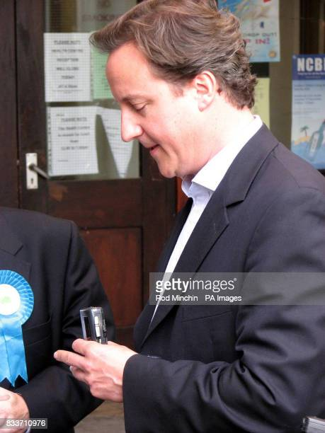 Tory leader David Cameron holds a dictaphone belonging to Northern Echo political editor Chris Lloyd during an interview during a tour of Newton...
