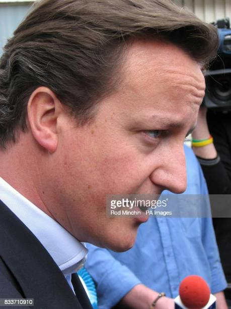Tory leader David Cameron speaks with reporters at Newton Aycliffe shopping centre while on the election trial