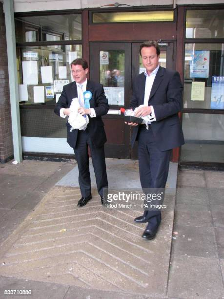 Tory leader David Cameron with Sedgefield byelection candidate Graham Robb pick up rubbish outside the health centre at Newton Aycliffe shopping...
