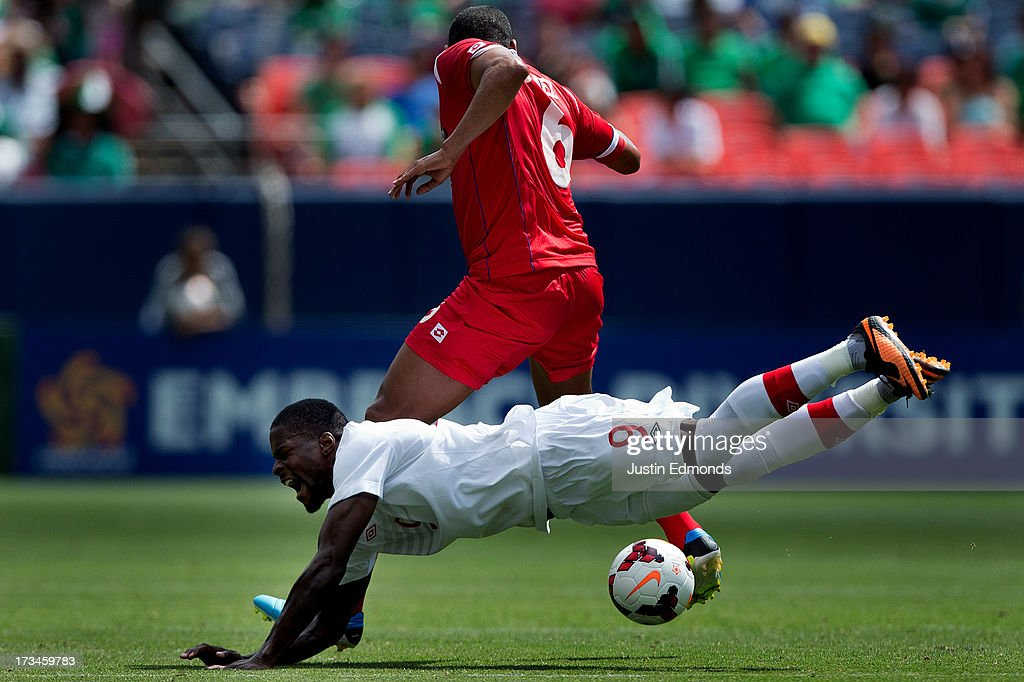 Tosaint Ricketts #9 of Canada is fouled by Gabriel Gomez #6 of Panama during the second half of a CONCACAF Gold Cup match at Sports Authority Field at Mile High on July 14, 2013 in Denver, Colorado. Canada and Panama played to a 0-0 draw.