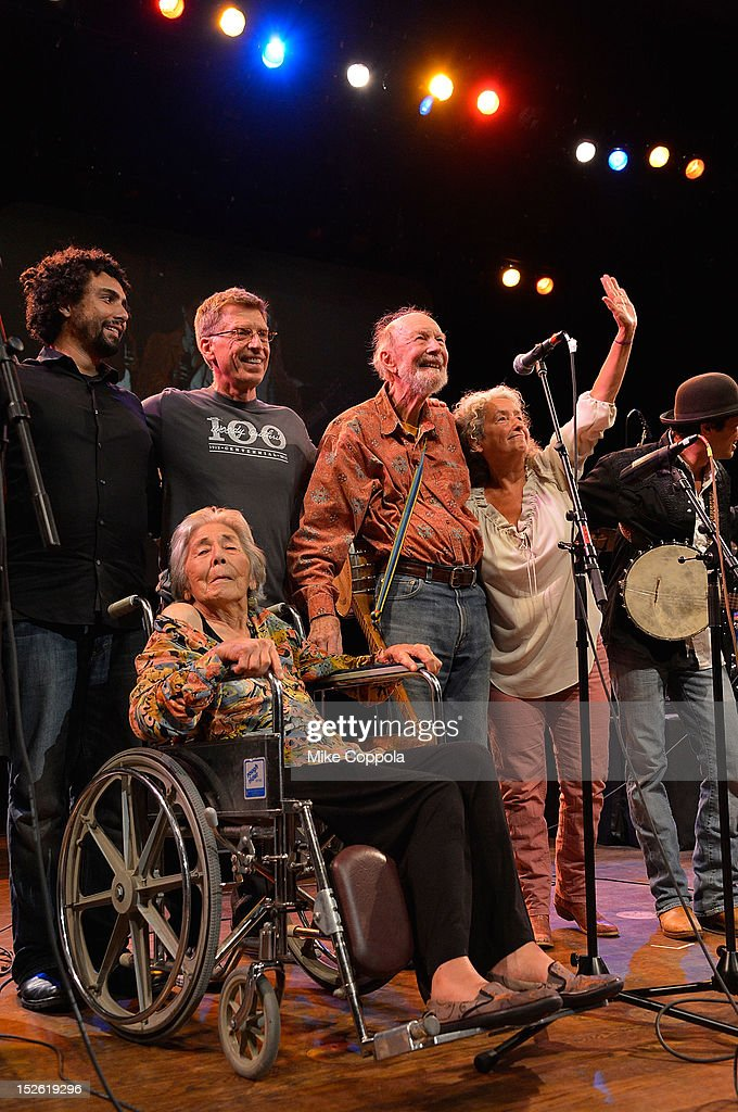 Toshi Seeger, Bob Santelli, Pete Seeger, and Nora Guthrie on stage during the 'This Land Is Your Land' Woody Guthrie At 100 Concert as part of the Woody Guthrie Centennial Celebration at The Whitman Theater at Brooklyn College on September 22, 2012 in New York City.