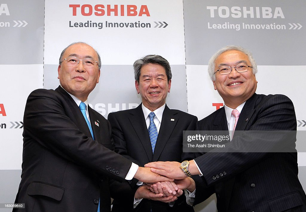Toshiba chairman <a gi-track='captionPersonalityLinkClicked' href=/galleries/search?phrase=Atsutoshi+Nishida&family=editorial&specificpeople=640193 ng-click='$event.stopPropagation()'>Atsutoshi Nishida</a>, senior executive vice president <a gi-track='captionPersonalityLinkClicked' href=/galleries/search?phrase=Hisao+Tanaka&family=editorial&specificpeople=10514426 ng-click='$event.stopPropagation()'>Hisao Tanaka</a> and president and chief executive officer <a gi-track='captionPersonalityLinkClicked' href=/galleries/search?phrase=Norio+Sasaki+-+Businessman&family=editorial&specificpeople=14807134 ng-click='$event.stopPropagation()'>Norio Sasaki</a> shake hands at a press conference at company headquarters on February 26, 2013 in Tokyo, Japan. Toshiba Corp.'s incoming president said he will abandon the company's current approach of emphasizing a few core sectors and focus instead on expanding overseas markets and developing new businesses.